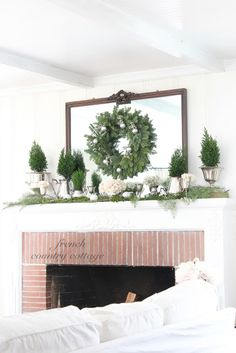 Mantel with silver pieces holding fresh greenery, a fresh green wreath on the mirror. FRENCH COUNTRY COTTAGE: Our Home