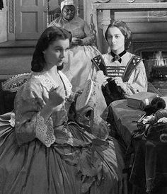 Mammy watches as Scarlett and Melanie do their sewing while Ashley, Frank, and Dr. Meade have gone to clean out the woods where Scarlett was attacked near Shantytown in 'Gone With The Wind' (1939)