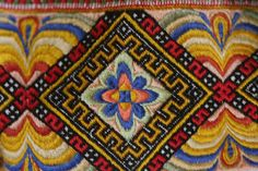 Evju-tunet - detail of hand embroidery from a bunad (traditional folk costume), Telemarken district, Norway.