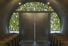 Hourglass Blueline Estate, a winery designed by San Francisco architect Olle Lundberg, is stripped-down in details but compelling close up. The entrance is framed by dozens of old bottles sawn in half, creating a stained glass effect. Photo: Doug Sterling / SF