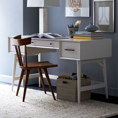 A desk that's no wallflower. Crafted of FSC®-certified wood and finished in white lacquer, this clean-lined desk combines a generous tabletop and three drawers. Finished on all four sides and surrounded by a beveled frame, it looks right at home floating in the center of a room.