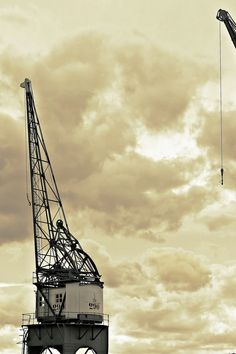 Free download of this photo: https://www.pexels.com/photo/architectural-photography-of-white-and-black-metal-crane-209123/ #clouds #cranes #industry