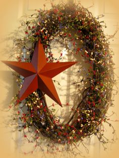 "This is for a  28"" Oval Wreath.... Green,  Light Purple, Cream and Red....with a 12"" Rusty Star....SO pretty!!! $39.99"