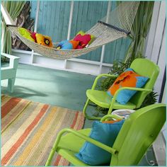 Love the bright colors here! Great color for a porch floor. Aqua is way more fun than typical porch grey!