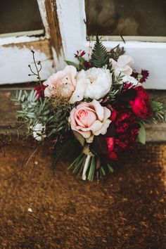 Cerise, burgundy and blush bouquet of peonies and garden roses for a Pennard House wedding by Bramble & Wild. Captured by Frankee Victoria Photography.