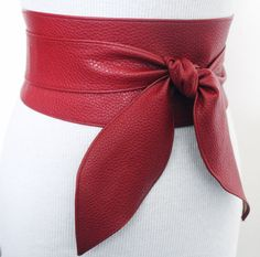 Red leather obi belt is made from real leather with a grainy finish. This beautiful belt will accentuate your style be it casual or formal. Cinch in