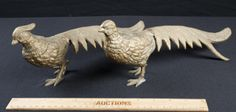 BRASS PAIR OF PHEASANTS BIRDS, WHICH ARE NATIVE TO ASIA. THESE ARE POSSIBLE MALE, THEY TYPICALLY HAVE MORE PLUMAGE THEN THE FEMALES DO. THEY MEASURE 12IN. LONG.