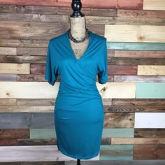 Teal Faux Wrap Dress - Small Petite Gorgeous jewel tone teal, flattering rouching at the waist. Double side slits. Comfortable knit material, that can easily be dressed up or down.    #woodsnap #officechic #classic #preppy #jeweltone #petitedress #vneckdress #flatteringfit Banana Republic Dresses