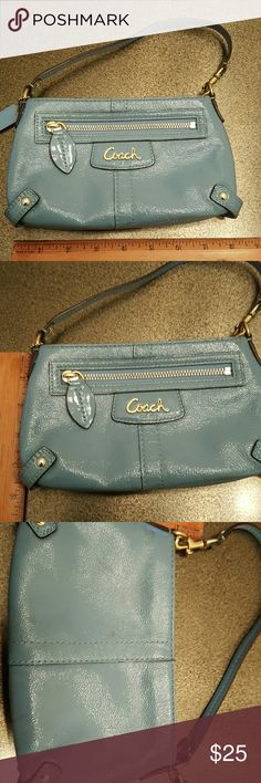 Authentic Coach clutch Pretty blue patent leather clutch.  Really good condition except for brown marks on back. Coach Bags Clutches & Wristlets