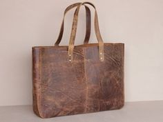 Our reviewer thought the Scaramanga leather shopper tote bag would make a great investment for a female home worker - http://www.workfromhomewisdom.com/product-reviews/laptop-bag-reviews/scaramanga-leather-shopper-tote-bag/