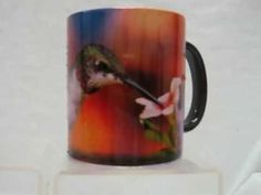 Unique one of a kind color changing coffee mug with a ruby throated hummingbird on it! The coffee mug is a dark color when cool add a warm drink into it and the black coating vanishes like magic! The bright colorful picture of the hummingbird comes to life while the mug is warm, when the cup cools down it goes back to the dark color until refill...