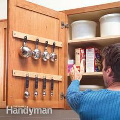 Hang items from cabinet doors to reduce drawer clutter and have easy access to high traffic items (eg. cutting boards and measuring cups)