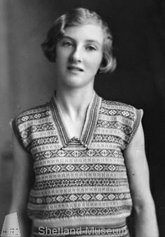 Item Details Photo Number	00100 Title	Girl in Fair Isle pullover Date of Photo	1930s Parish	Not in Shetland Description Jean Jarmson wearing sleeveless Fair Isle rayon jumper, studio fashion photo, taken in Aberdeen. She won a prize for this jumper. See also 01344.