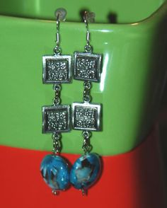 blue and silver tone earrings