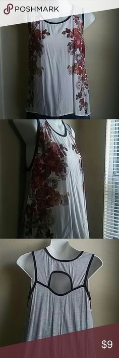 Two tone tank top Comfortable thank top flowers on sides gray on back .very cute lowon front long on back Xhilaration Tops Tank Tops