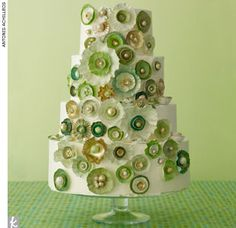 Buttercream wedding cake covered with hand-painted green and gold pottery and shell-inspired sugar accents by Nine Cakes, NineCakes.com    > Find your wedding cake baker    > See 7 more wedding cakes here!