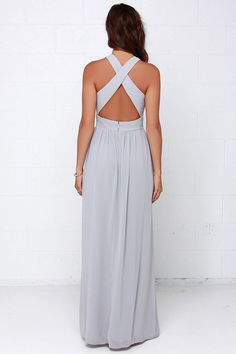Look as though you've just stepped out of your own mystical daydream in the Chimerical Creation Grey Maxi Dress! Lightweight Georgette shapes an elegant, crossing halter neckline amidst a bodice with princess seams, lightly padded cups and more crossing detail at back. A sweeping maxi skirt falls effortlessly from a banded, empire waist. Hidden zipper with clasp. Fully lined. 100% Polyester. Hand Wash Cold.