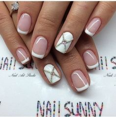 French Tips Studded with Rhinestones. Nothing is perfect than a French tip with a nail studded with Rhinestone and chain.