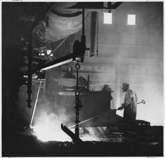 """Tapping a blast furnace at the M. A. Hana Steel Co., near Buffalo, N.Y.""  By Thomas W. Parker, ca. November 1949–January 1950  While the steel industry had adopted the eight-hour day in the 1920s, the workday of American steel workers was still difficult, hot, and dangerous. Wages were below subsistence level, and accidents frequently killed or maimed workers. After unionization, in the late 1930s, wages rose and working conditions improved."