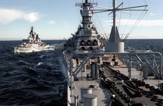 The West German destroyer FGS Schleswig-Holstein (D-182) refuels from the battleship USS Iowa (BB-61) during NATO Exercise Northern Wedding '86