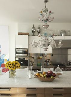 A Venetian glass chandelier in the kitchen and you have seven kids - that's brave!