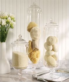 Glass containers to hold soaps, salts, bath essentials.