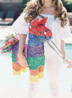 A colorful pinata: http://www.stylemepretty.com/2016/04/29/cinco-de-mayo-wedding-party-theme/ | Photography: Allison Kuhn - http://allisonkuhnphotography.com/