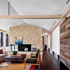 Bright, open living area with a vaulted ceiling and central fireplace