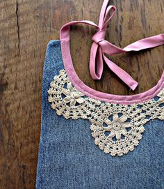 This sweet baby bib is made from upcycled denim jeans & vintage sheets with new cotton straps. Nathalie-Roze bibs make stellar gifts for new