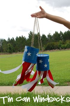 4th of July Tin Can Windsocks: by Random Thoughts of a SUPERMOM: Use some of this: http://www.rustoleum.com/product-catalog/consumer-brands/stops-rust/protective-enamel-spray/ on old cans, stick white contact paper stars and hot glue some strips of red and white! Easy, fun and affordable craft the kids can help with and play with!