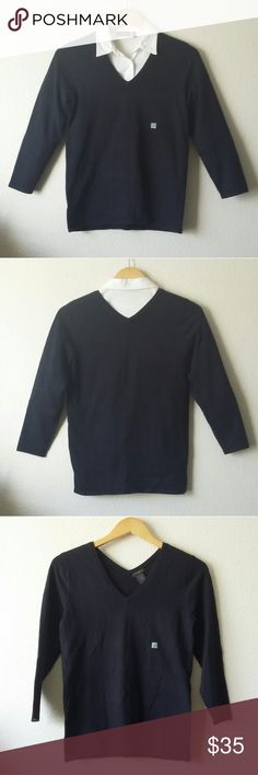 Ann Taylor Factory v-neck sweater top (NWT) Ann Taylor Factory v-neck sweater with 3/4 sleeves in a very dark blue/black color depending on the lighting. The material feels very soft and has some stretch. Perfect for layering during the colder seasons. Size small. New with tags. 72% Viscose, 28% Polyester. Length 23.5, bust 16.5 (unstretched), sleeves 19. White button down shirt not included with the sweater. And in case anyone is wondering, the small pale square on the front of the sweater…