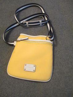 599b42a1e27933 Michael Kors Yellow Cross Body Bag. Get the trendiest Cross Body Bag of the  season