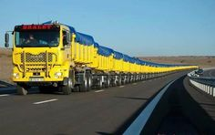 The Longest Truck in the World...  a road train is a trucking concept used in remote areas of Argentina, Australia, Mexico, the US & Canada to move freight efficiently. Instead of pulling one trailer, a road train pulls two or more of them. On 2/18/06 a Mack truck with 112 semi-trailers, 1,300 tons & 4,836 ft long, pulled the load 328 feet to a new record  for a single mover. It was in Clifton, Queensland, that 70-year-old John Atkinson claimed a record, pulled by a tri-drive Mack Titan.