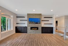 I would love these cabinets on the side of the fireplace!  #craftcontemporary stone. #greatnwhomes #billjohnsonphotography #creativemines