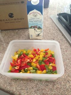 Food prepping - chopped bell peppers and carton of egg whites