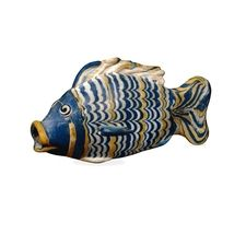 Glass bottle in the form of a fish    From el-Amarna, Egypt  18th Dynasty, around 1390-1336 BC    The tilapia: symbolic of rebirth