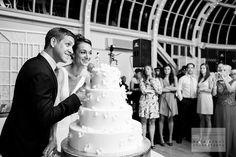 Black and White Photo of Bride and Groom Cutting Cake. Brooklyn Botanic Gardens, The Palm House Wedding. Brooklyn, NY. ©SaraWightPhotography