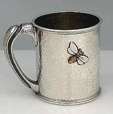 Whiting sterling silver cup with copper application and fine hammered surface.  Inscribed with presentation on base and side.  Copper cherry branch with brass leaves on other side.