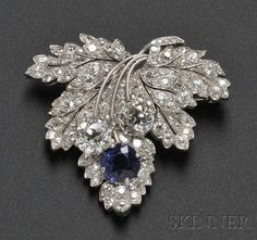 Art Deco Platinum, Sapphire, and Diamond Leaf Brooch, Paul Flato, set with a cushion-cut sapphire measuring approx. 6.50 x 6.50 x 4.00 mm, and two old European-cut diamonds weighing approx. 1.12 and 1.20 cts., further set with old mine-, old European-, and single-cut diamonds, 1 1/2 x 1 3/8 in., signed, with photocopy of receipt dated December 3, 1935.