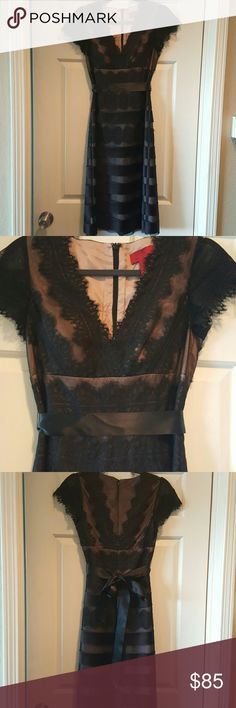 JS Collections black lace dress Black sheer lace over a nude lining. Back zip and optional satin tie. Flattering shape and bust has additional cups lining. Worn once. JS Collections Dresses Midi