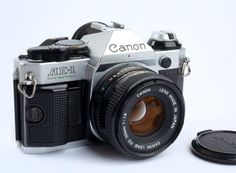 Canon AE-1 Program 35mm Camera with the Canon FD 50mm f1.8 Lens and front cap or a 52mm filter. Excellent working conditions with no issues.No Canon shutter squeaks. Camera works perfectly! Not film tested. | eBay!
