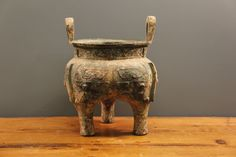 Metal Bowl, possible modelled on elephants.