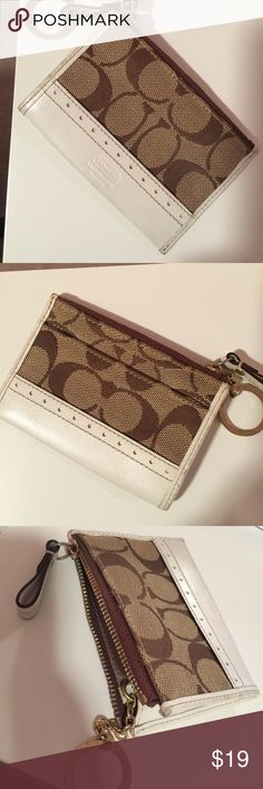 """Coach Mini Skinny This Mini Skinny from Coach is so cute, you can put all your essentials credit cards & money that you need on the go.  The condition is good, the interior is very clean, the exterior trimming has a little minor dust stain, it's not even noticable( but please refer to the image for detail) Approximately: 4.5"""" L x 3"""" H Coach Bags Wallets"""