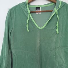 "Patagonia Velour Hoodie - never worn Patagonia ""rhythm"" green velour pullover hoodie with 2 side pockets and contrasting cotton green trim around neck and good. Super soft. Never worn. Size women's medium. 80% organic cotton, 29% polyester. Patagonia Sweaters"