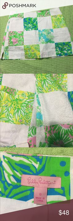 Lilly Pulitzer skort. Size 0! Lilly Pulitzer. Size 0 skort. Zipper on the side. White lining. Only problem is the button by the zipper is falling off( could easily be sewn back on) I have never used the button. Worn twice. Lilly Pulitzer Shorts Skorts