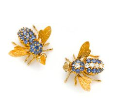 A collection of two sapphire and diamond bee brooches