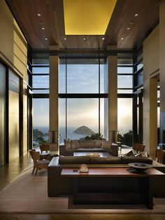 Located in Shek-O, a historic fishing village in the southeast corner of Hong Kong Island, this house takes full advantage of its prominent rural site. Overlooking the South China Sea, the design includes broad expanses of glass opening to views in every direction. #architecture (Interior Design: Olson Kundig Architects, Photographer: Benjamin Benschneider)