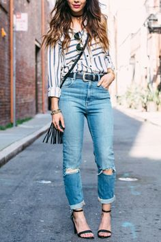 Striped button down, distressed denim, and heels.