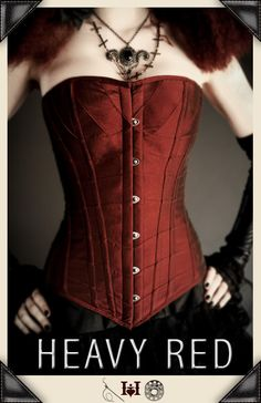 The Rouge Reverence  corset is binding, beautiful and appropriate for waist training. It will indeed give you that perfect hourglass figure. This maroon (the perefct shade of deep muted red) taffeta corset has 12 heavy steel boned panels.