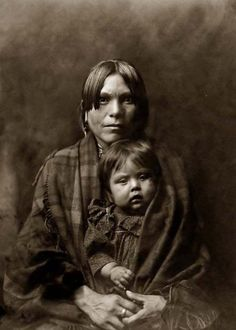 by Buyenlarge - North American Tribal Culture - Getty Images - Half-length portrait of mother and child facing front. - January 01, 1905 - License